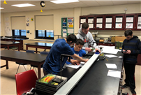Physics Students Practice Skills Pic